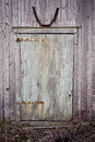 Barn door old wood with faded blue green paint and rusty hinges the picture was taken during spring season Stock Photo