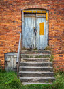 Barn door old worn wooden exterior with stone steps and wooden banister rail Stock Photo