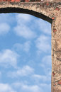 Barn gate door arch and sky, stone wall closeup, vertical bright white summer clouds cloudscape copy space background, plastered Royalty Free Stock Photo