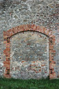 Barn gate door fake false faux arch, stone wall background frame closeup, vertical limestone copy space, green grass Royalty Free Stock Photo