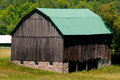 Barn with green roof Royalty Free Stock Photography
