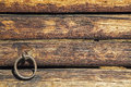 Barn log wall cinch ring livestock background the ancient wooden with metal tack is weathered and cracked Stock Photos