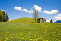 Barn on hill in Prealps Royalty Free Stock Photo