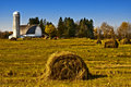 Barn with Rolls of Hay, Wisconsin Stock Photography