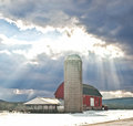 Barn scene in winter with sun rays Royalty Free Stock Photo