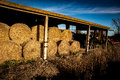 Barn with straw rolls Royalty Free Stock Photo