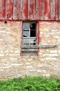 Barn swallow flying out abandoned old farm window a bird is the of an building Stock Photo