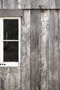 Barn window picture of the outside wall of an old wooden with a white framed the composition of the picture cuts the in Stock Photography