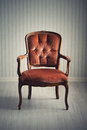 Baroque armchair chair in an empty room Stock Photography