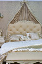 Baroque bedroom style interior in beige colors Stock Image