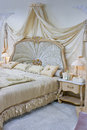 Baroque bedroom style interior in beige and mauve colors Stock Image