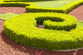 Baroque boxwood hedges against trickling brick gravel paths public park Stock Photography