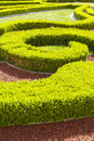 Baroque boxwood hedges against trickling brick gravel paths public park Stock Photos