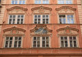 Baroque building with ornate windows in Prague, Czech Republic Royalty Free Stock Photo