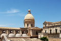 Baroque chatedral of noto the restored dome an overall view with sicily landscape cut Royalty Free Stock Photo