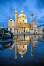 Baroque church karlskirche in vienna austria even august located on the south side of karlspaltz reflected the surface of the Royalty Free Stock Image