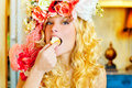 Baroque fashion blonde woman eating dona Royalty Free Stock Image