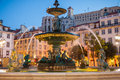 Baroque fountain rossio square at dusk lisboa portugal Stock Photography