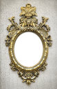 Baroque frame beautiful and complex golden hanged on a textured wall Royalty Free Stock Photos