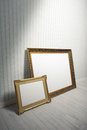 Baroque frames two in a empty room Stock Photography