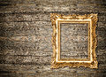Baroque golden frame over wooden background. Grungy texture Royalty Free Stock Photo