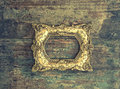 Baroque golden frame on wooden background. Grunge texture Royalty Free Stock Photo