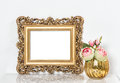 Baroque golden picture frame and rose flowers. Vintage style moc