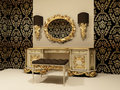 Baroque table with mirror on the wallpaper backgro