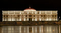 Baroque theater on the bay of the river new structure who shinning in the night like a night guard of the city Royalty Free Stock Photography