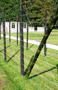 Barrack behind barbed wire in a concentration camp Royalty Free Stock Images