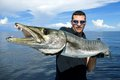 Barracuda lucky fisherman holding a giant Stock Photo