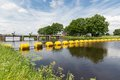 Barrage in dutch river vecht with floating barricade a yellow Royalty Free Stock Photography