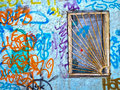 Barred window, wall with graffity Royalty Free Stock Image
