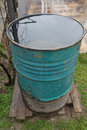 Barrel filled with rain water old metallic after a big Royalty Free Stock Photography