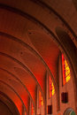 Barrel vaulted ceiling of the mission delores basilica illuminated by glow stained glass windows in san francisco Stock Photo