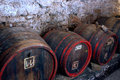 Barrels in cellar Stock Images