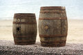 Barrels two old wooden for distilled beverage at a flea market in brittany france Royalty Free Stock Image