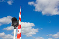 Barrier and traffic light of bridge against blue sky Stock Image