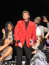 Barry manilow live with backup singers performing his Royalty Free Stock Images