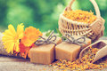 Bars of homemade soaps and calendula flowers. Royalty Free Stock Photo