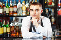 Bartender at bar portrait of young barman worker desk in restaurant Stock Photos