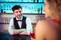 Bartender looking at woman in nightclub Royalty Free Stock Photo
