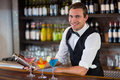 Bartender mixing a cocktail drink in cocktail shaker Royalty Free Stock Photo