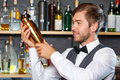 Bartender mixing drinks Royalty Free Stock Photo