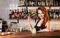 Bartender sexy redhead with coctail Stock Photos