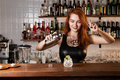 Bartender sexy redhead with coctail Royalty Free Stock Photo