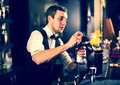 Bartender young man working as a in a nightclub bar Stock Photos