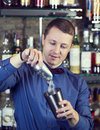 Bartender young man working as a in a nightclub bar Royalty Free Stock Photos