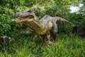 Baryonyx standing in tall grass display model in perth zoo as part of zoorassic exhibition march Stock Photography