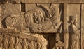 Bas Relief of Lion and Bull Fighting Beside an Achaemenid Soldier in Persepolis Royalty Free Stock Photo
